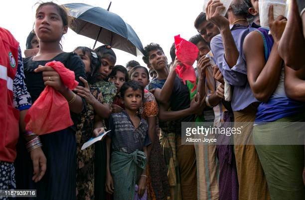 Rohingya refugees queue for a blanket distribution in a refugee camp on December 11, 2019 in Cox's Bazar, Bangladesh. The UN's International Court of...