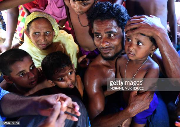 Rohingya refugees react before receiving an oral cholera vaccine at the Thankhali refugee camp in Ukhia district on October 10 2017 The United...