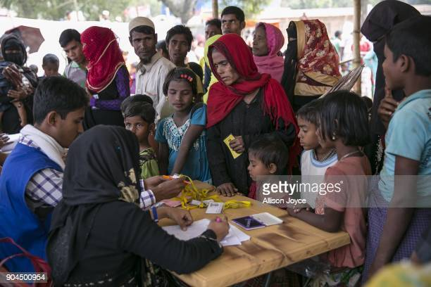COX'S BAZAR BANGLADESH JANUARY 13 Rohingya refugees register for aid January 13 2018 in Cox's Bazar Bangladesh Over 650000 Rohingya have crossed the...