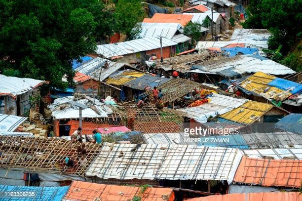 Rohingya refugees renovate makeshift houses at Kutupalong refugee camp in Ukhia district on August 23 2019