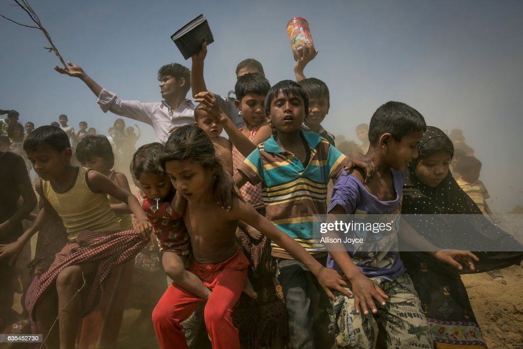 Rohingya refugees run to the crew of the Nautical Aliya as they provide relief supplies at the Balu Khali Rohingya refugee camp on February 15, 2017 in Chittagong, Bangladesh. The Rohingya aid ship, Nautical Aliya, carrying 2,200 tons of rice, emergency supplies and aid-workers, docked at Chittagong Port, about 140km from Cox's Bazar where thousands of Rohingya Muslims have taken refuge. Around 70,000 Rohingya Muslims have fled to Bangladesh from Myanmar since October last year after the Burmese army launched a campaign it calls 'clearance operations' in response to an attack on border police. According to reports, Bangladesh plans to proceed with a controversial plan to relocate tens of thousands of Rohingya refugees from Myanmar to a remote island in Bay of Bengal, despite warnings it is uninhabitable and prone to flooding. The Rohingya, a mostly stateless Muslim group numbering about 1.1 million, are the majority in Rakhine state and smaller communities in Bangladesh, Thailand and Malaysia.