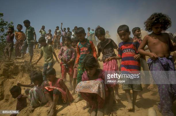 Rohingya refugees run to the crew of the Nautical Aliya as they provide relief supplies at the Balu Khali Rohingya refugee camp on February 15 2017...