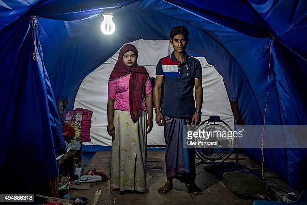 Rohingya refugees Sayot Amin and his wife Manu Begum stands at a temporary shelter in Bayeun as some 1000 Rohingya Muslims remain in limbo on October...