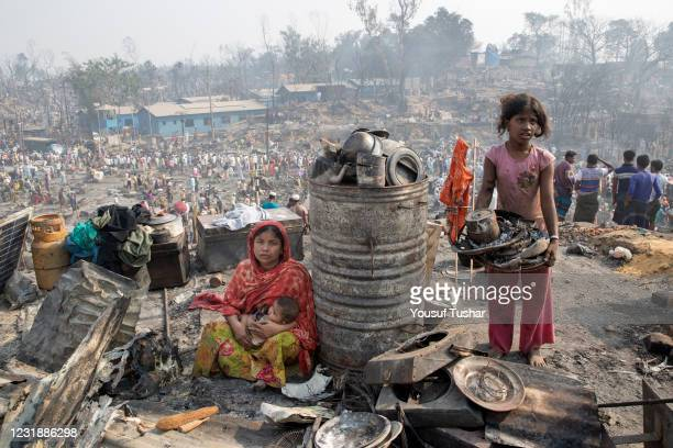 Rohingya refugees search for their belongings after a fire broke out at Balukhali rohingya refugees camp, Cox's Bazar. A huge fire swept through a...