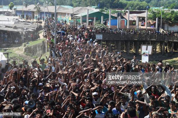TOPSHOT Rohingya refugees shout slogans at a protest against a disputed repatriation programme at the Unchiprang refugee camp near Teknaf on November...