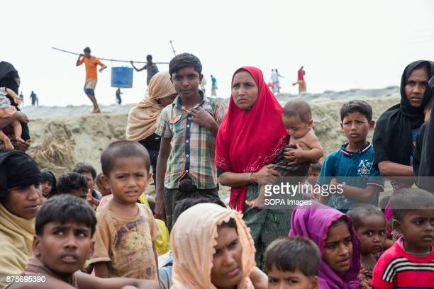 Rohingya refugees sit waiting to be taken to registration close to the Myanmar Bangladesh border Thousands of Rohingya refugees continue to cross the...