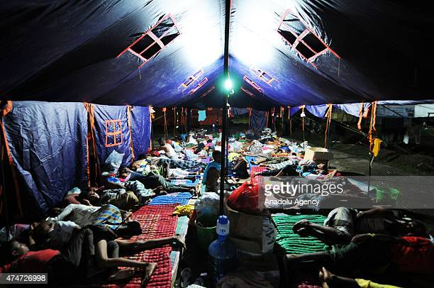 Rohingya refugees sleep at a temporary shelter in Bayeun Village Aceh Province Indonesia on May 25 2015 Indonesia has begun search and rescue...