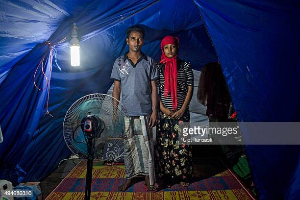 Rohingya refugees Syaifullah and his wife Yasminara Begum stands at a temporary shelter in Bayeun as some 1000 Rohingya Muslims remain in limbo on...