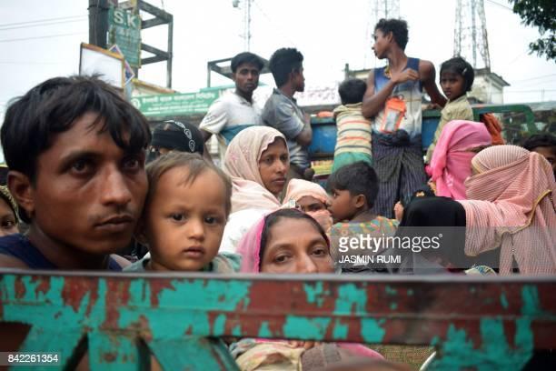 TOPSHOT Rohingya refugees travel on an openback truck on TeknafCox's Bazar highway near Kutupalong refugee camp in Ukhiya Bangladesh on September 3...
