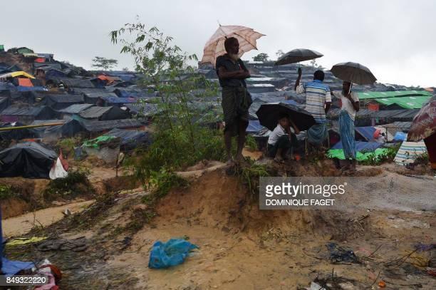 TOPSHOT Rohingya refugees wai under rain at Kutupalong refugee camp in the Bangladeshi locality of Ukhia on September 19 2017 Pressure grew on...