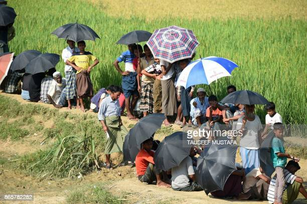 TOPSHOT Rohingya refugees wait for relief aid at Balukhali refugee camp in the Bangladeshi district of Ukhia on October 24 2017 Nations have pledged...