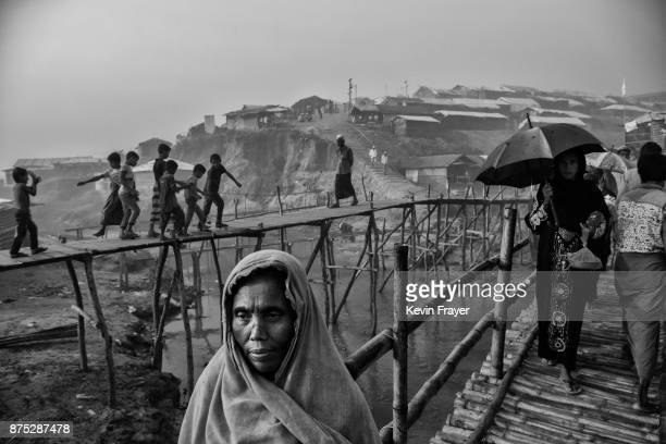 COX'S BAZAR BANGLADESH OCTOBER 27 Rohingya refugees walk on makeshift bamboo bridges on October 27 2017 at the Kutupalong refugee camp near Cox's...