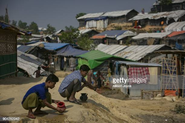 COX'S BAZAR BANGLADESH JANUARY 12 Rohingya refugees wash before Friday prayers in Balukhali camp on January 12 2018 in Cox's Bazar Bangladesh Over...