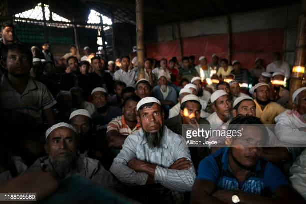 COX'S BAZAR BANGLADESH DECEMBER 12 Rohingya refugees watch ICJ proceedings at a restaurant in a refugee camp on December 12 2019 in Cox's Bazar...