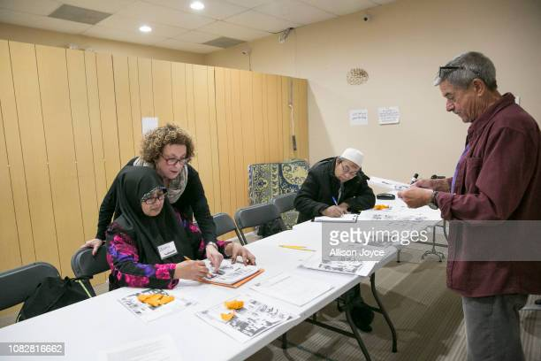 Rohingya refugees Zulah and Abdullah Rahman participate in an English class at the Rohingya Cultural Center of Chicago on January 10 2019 in Chicago...