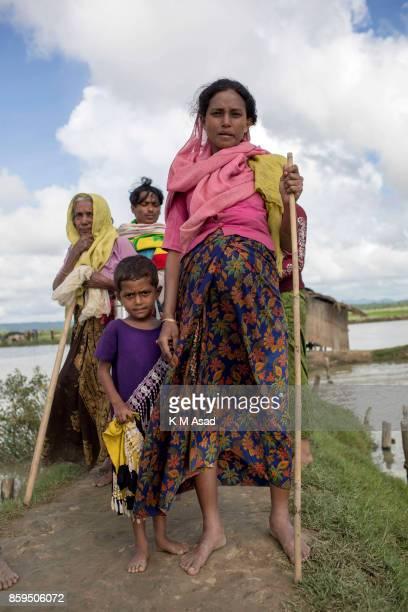 Rohingya Rohingya pregnant woman crossing Bangladesh's border as she flees from Buchidong at Myanmar after crossing the Naf River in Bangladesh...