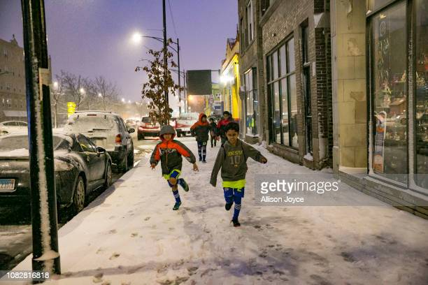 Rohingya soccer players play in the snow as they leave a game January 12 2019 in Chicago Illinois Chicago has one of the largest number of Rohingya...