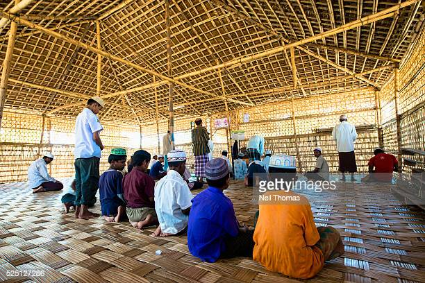 Rohingya villagers continue to practice their Muslim faith in a temporary mosque at Sittwe IDP camp Many mosques were destroyed during the violence...