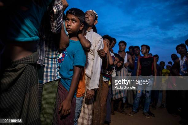 Rohingya wait in line for humanitarian aid in Kutupalong camp August 27 2018 in Kutupalong Cox's Bazar Bangladesh UN investigators said on Monday...