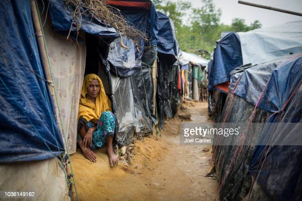 rohingya woman and shelters at kutupalong refugee camp in bangladesh - refugee camp stock pictures, royalty-free photos & images