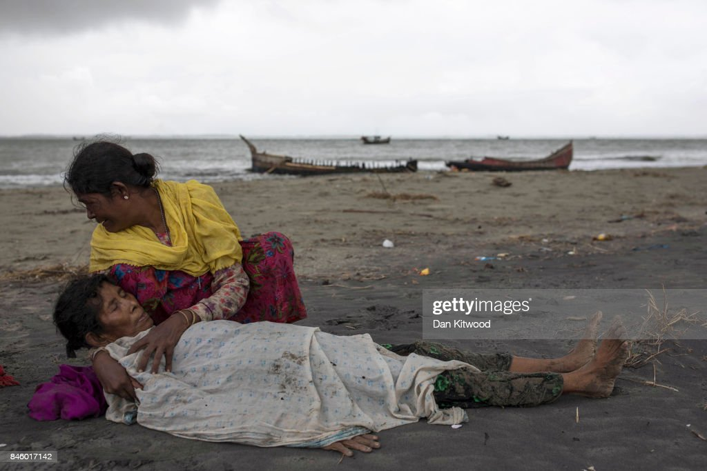 A Rohingya woman comforts an elderly woman, after the wooden boat they were travelling on from Myanmar crashed into the shore and tipped everyone out on September 12, 2017 in Dakhinpara, Bangladesh. Recent reports have suggested that around 290,000 Rohingya have now fled Myanmar after violence erupted in Rakhine state. The 'Muslim insurgents of the Arakan Rohingya Salvation Army' have issued statement that indicates that they are to observe a cease fire, and have asked the Myanmar government to reciprocate.