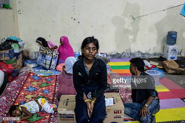 Rohingya woman sits rest inside temporary shelter on May 17 2015 in Kuala Langsa Aceh province Indonesia Hundreds of Myanmar's Rohingya refugees...
