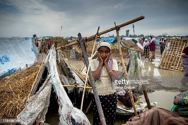 Rohingya woman stands in shock after her tent in the IDP refugee camps of Sittwe is completely destroyed by a storm Sittwe now has over 125000 people...