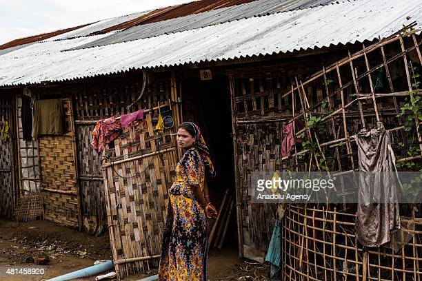 Rohingya woman stands outside of her tent inside the IDP camps in Sittwe Rakhine State Myanmar on July 18 2015 An estimated 110000 ethnic Rohingya...