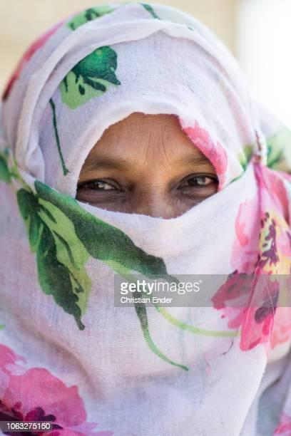 Kutupalong Ukhiya near Cox´s Bazar Bangladesh October 16 2018 A Rohingya woman wearing a colorful niqab in the refugee camp of the Rohingya people...