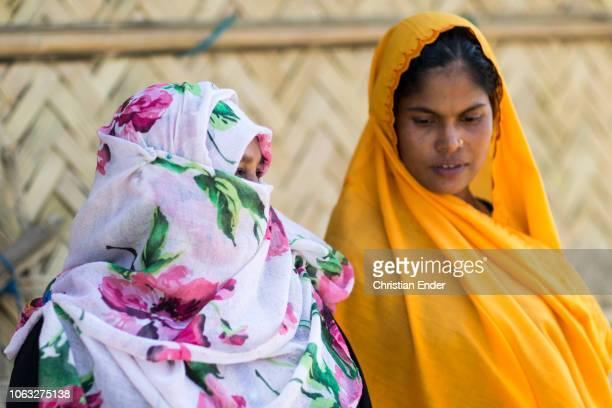 Kutupalong Ukhiya near Cox´s Bazar Bangladesh October 16 2018 A Rohingya woman wearing a niqab is talking with woman wearing a hijab in the refugee...