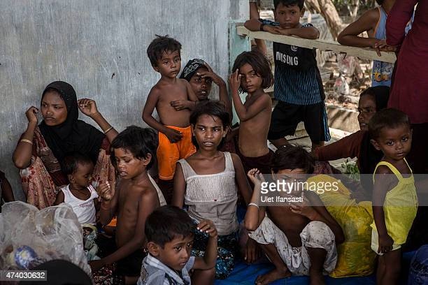 Rohingya women and children are seen after arriving at the port in Julok village on May 20 2015 in Kuta Binje Aceh Province Indonesia Hundreds of...