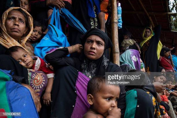 Rohingya women and children wait in line for a food distribution of super cereal at Action Against Hunger Action Contre La Faim in Kutupalong camp on...