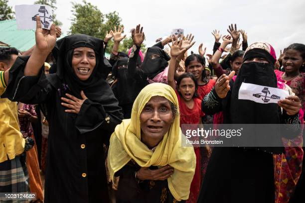 Rohingya women protest on the first anniversary of the Rohingya crisis August 25 2018 in Kutupalong Cox's Bazar Bangladesh Myanmar's military...