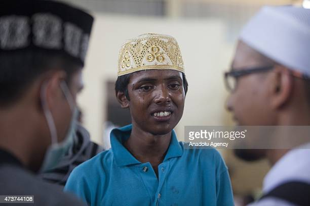 Rohingya young migrant cries while talking to people from the local Muslim community in a warehouse in Kuala Langsa Port in Langsa Aceh province...