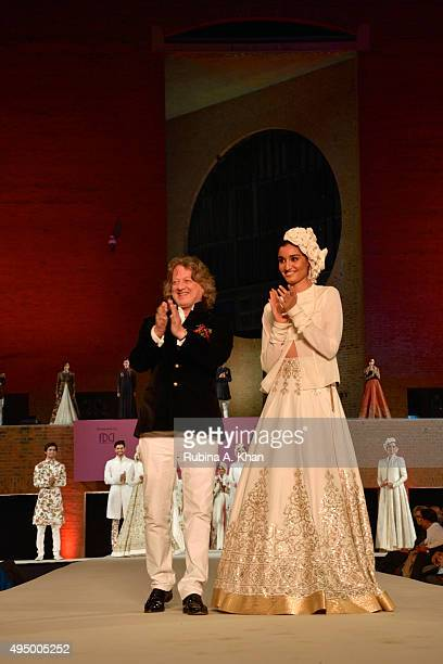Rohit Bal takes a bow at the Fashion Design Council of India's Huts to High Street a fashion show organised to promote khadi alongwith the Gujarat...
