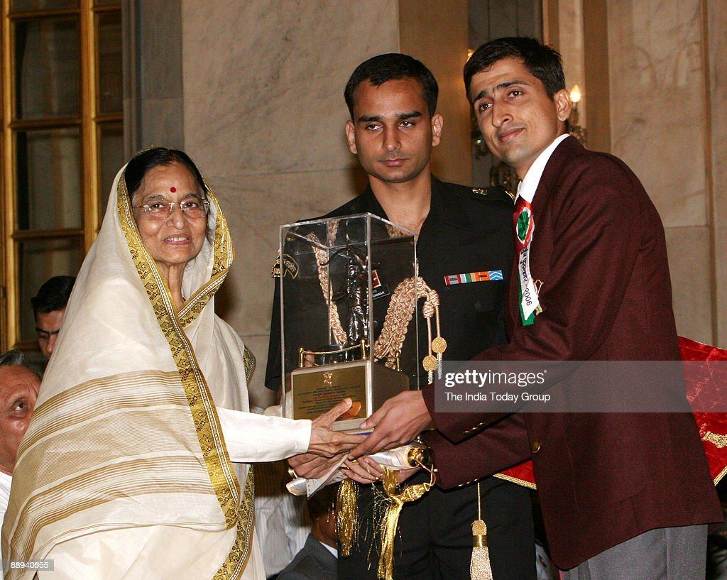 Rohit Bhaker, Badminton Player Receiving the Arjuna award from Pratibha Devisingh Patil, President of India (Pratibha Patil) in New Delhi, India : News Photo