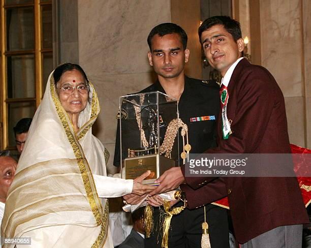 Rohit Bhaker Badminton Player Receiving the Arjuna award from Pratibha Devisingh Patil President of India in New Delhi India