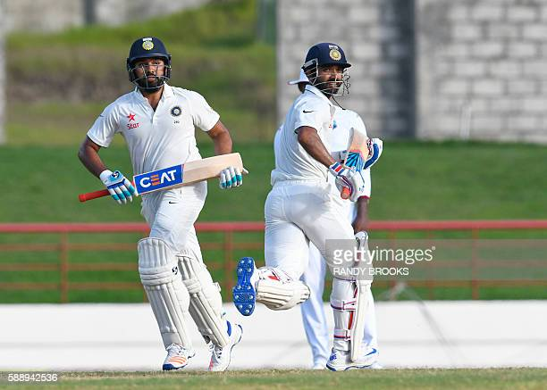 Rohit Sharma and Ajinkya Rahane of India 85 run partnership during day 4 of the 3rd Test between West Indies and India at Darren Sammy National...