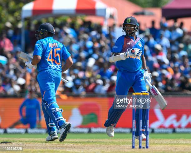 Rohit Sharma and Shikhar Dhawan of India during opening partnership during the 2nd T20i match between West Indies and India at Central Broward...