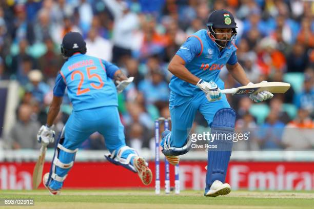 Rohit Sharma and Shikhar Dhawan of India run between the wickets during the ICC Champions trophy cricket match between India and Sri Lanka at The...
