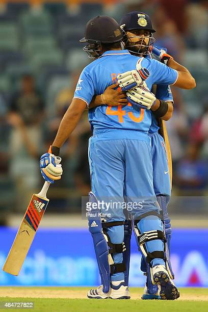Rohit Sharma and Virat Kohli of India celebrate after winning the 2015 ICC Cricket World Cup match between India and the United Arab Emirates at WACA...