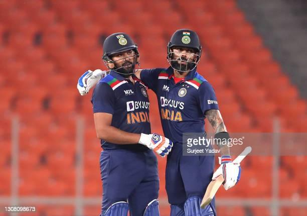 Rohit Sharma celebrates reaching his 50 along side Virat Kohli during the 5th T20 International between India and England at Narendra Modi Stadium on...