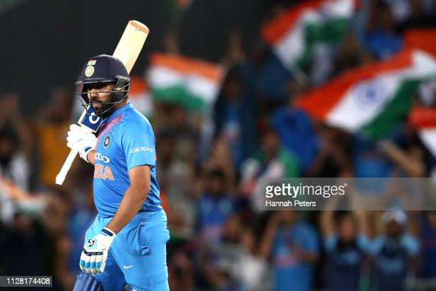 Rohit Sharma of India acknowledges the crowd after scoring fifty runs during game two of the International T20 Series between the New Zealand Black...
