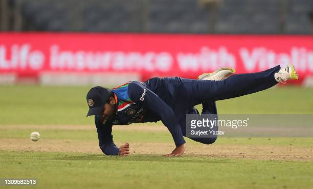 Rohit Sharma of India attempts to field the ball during the 3rd One Day International match between India and England at MCA Stadium on March 28,...