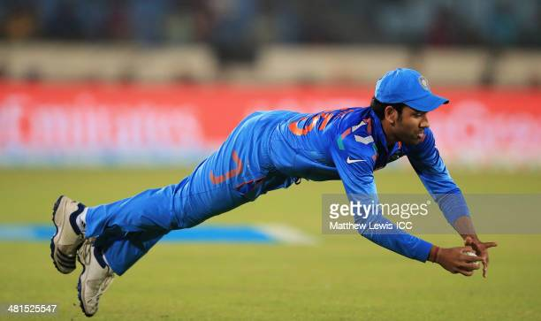 Rohit Sharma of India catches David Warner of Australia during the ICC World Twenty20 Bangladesh 2014 match between India and Australia at...