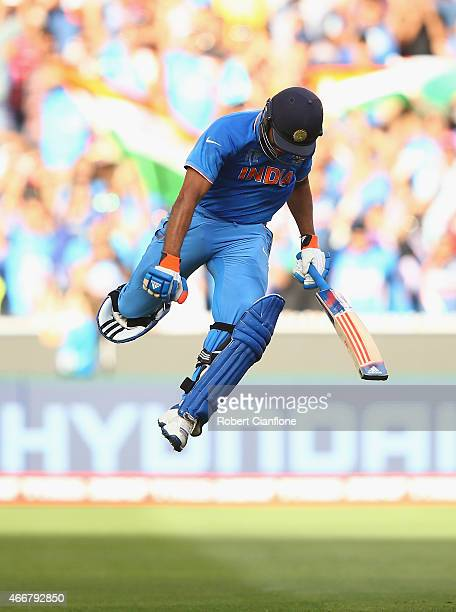 Rohit Sharma of India celebrates after scoring his century during the 2015 ICC Cricket World Cup match between India and Bangldesh at Melbourne...