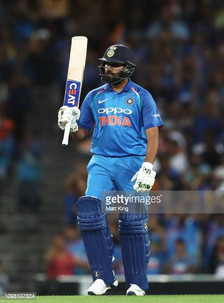 Rohit Sharma of India celebrates and acknowledges the crowd after scoring a century during game one of the One Day International series between...