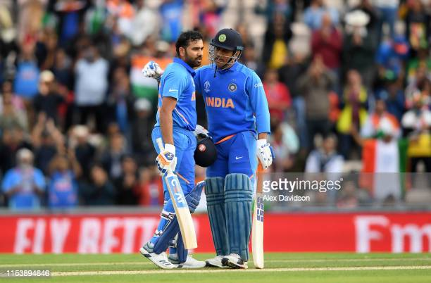 Rohit Sharma of India celebrates his century with MS Dhoni of India during the Group Stage match of the ICC Cricket World Cup 2019 between South...
