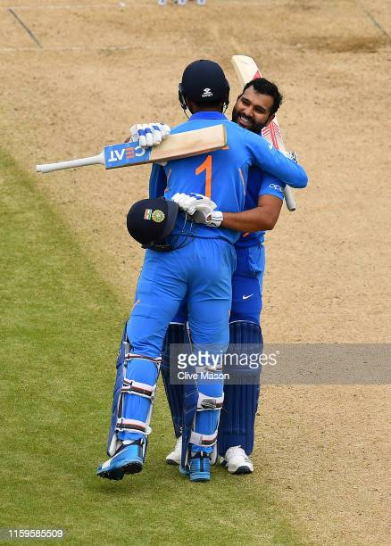 Rohit Sharma of India celebrates his century with KL Rahul of India during the Group Stage match of the ICC Cricket World Cup 2019 between Bangladesh...
