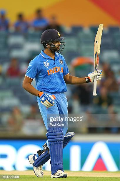 Rohit Sharma of India celebrates his half century during the 2015 ICC Cricket World Cup match between India and the United Arab Emirates at WACA on...